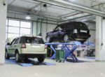 11026321-Cars-on-the-elevator-in-a-repair-garage-Stock-Photo-car-workshop-repair